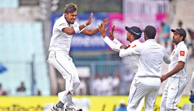 Sri Lanka fast bowler Suranga Lakmal celebrates taking the wicket of Indian opener Lokesh Rahul for a duck on the opening day of the first cricket Test at Eden Gardens, Kolkata on Thursday. – AFP