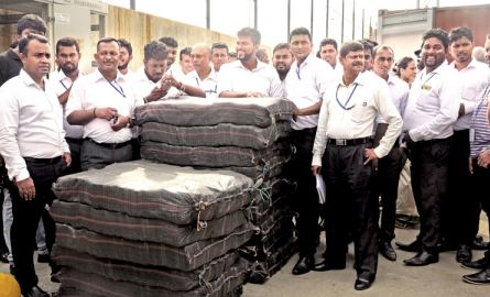 Police Narcotics Bureau officials with the support of Sri Lanka Customs and Navy yesterday recovered a haul of cocaine weighing 800 kgs  hidden in a ship docked at the Colombo Port. PNB officials said that this ship was bound to India from Ecuador and drugs were hidden in a timber container. Picture shows officials inspecting the cocaine recovered from the container   Picture by Susantha wijegunawardena