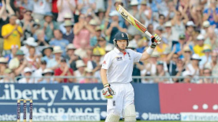 Englands Ian Bell raises his bat after reaching 50 runs during the third day of the first Ashes cricket test match between England and Australia at Trent Bridge in Nottingham, central England, on July 12.  AFP