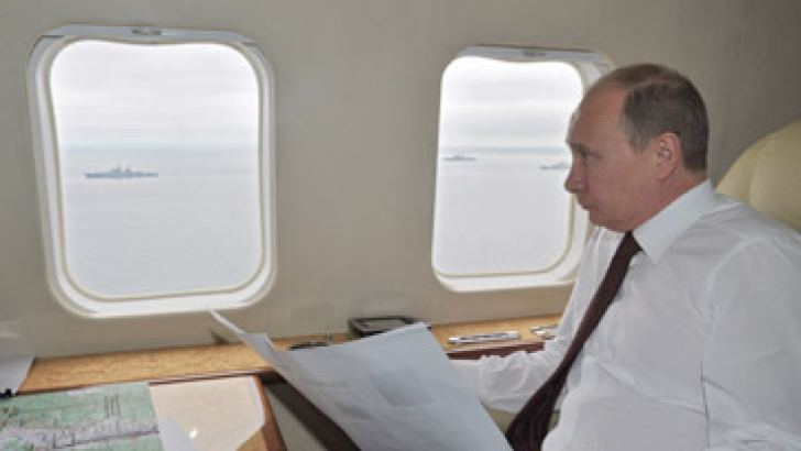 Russian President Vladimir Putin inspects military exercises in the Pacific Ocean near the Sakhalin island on July 16. AFP