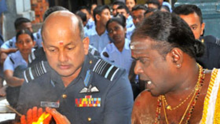 Air Force Commander Air Marshal Harsha Abeywickrama participating at the religious ceremony. Picture by Saman Sri Wedage