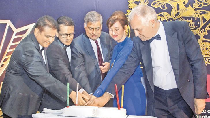 The Chartered Institute of Management Accountants (CIMA) celebrated its 50th anniversary at Cinnamon Grand on Thursday with Prime Minister Ranil Wickremesinghe as the Chief Guest. Here, the Prime Minister is seen with CIMA President Myriam Madden, CIMA CEO Charles Tilley and other invites cutting the anniversary cake. A special first day cover was also issued by the Philatelic Bureau of Sri Lanka and the Postal Services Ministry to commemorate this milestone. Picture by Sulochana Gamage