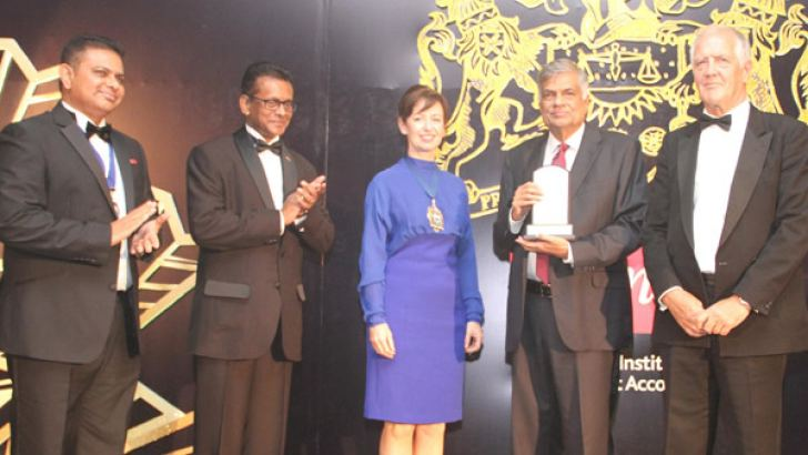 Prime Minister Ranil Wickremesinghe with CIMA President Myriam Madden, CIMA CEO Charles Tilley and other invitees. A special first day cover was also issued by the Philatelic Bureau of Sri Lanka and the Postal Services Ministry to commemorate CIMA Sri Lanka 50th Anniversary celebrations. Picture by Sulochana Gamage