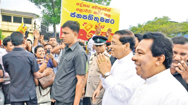President Maithripala Sirisena returned to the island yesterday to a rousing welcome at the Bandaranaike International Airport, Katunayake. Large crowds were among the politicians who flocked to the BIA to receive the President who returned from New York after addressing the 70th United Nations General Assembly sessions. Religious leaders led by the Maha Sangha blessed the President at the VIP lounge. Picture by Sudath Malaweera