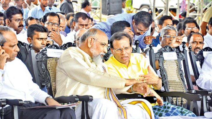 President Maithripala Sirisena and Northern Provincial Council Chief Minister C.V.Vigneswaran at the National Programme for Local Food Production in Iranamadu yesterday. Picture by Sudath Malaweera