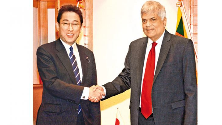 Prime Minister Ranil Wickremesinghe with Japan's Foreign Minister Fumio Kishida at the Imperial Hotel in Tokyo yesterday