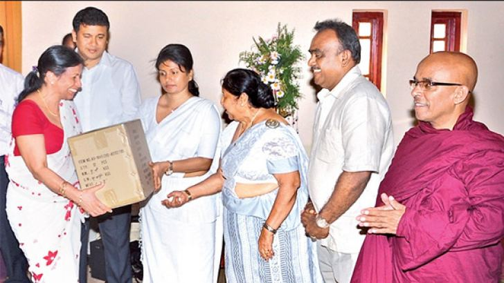 Chathurika Sirisena symbolically handing over the medical equipment to Central Province Health Services Director Dr. Shanthi Amarasinghe. Picture by Gamini Ranasinghe.