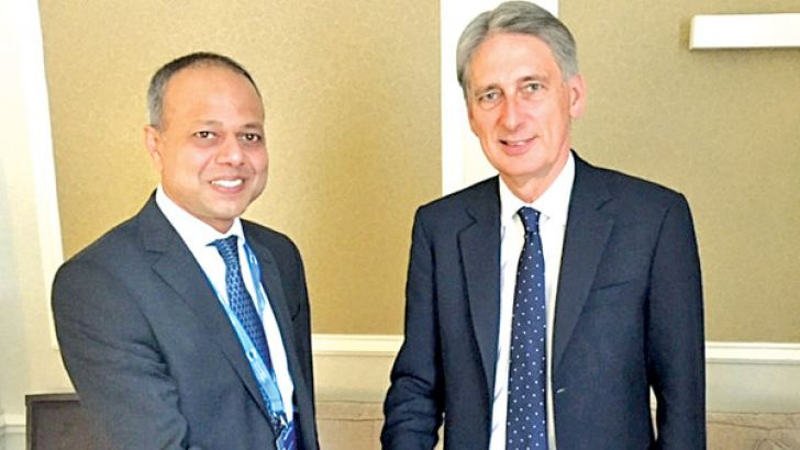 Southern Development Minister Sagala Ratnayaka who is in London seeking investments and training for government servants meeting Secretary of State for Foreign and Commonwealth Affairs Philip Hammond, MP.
