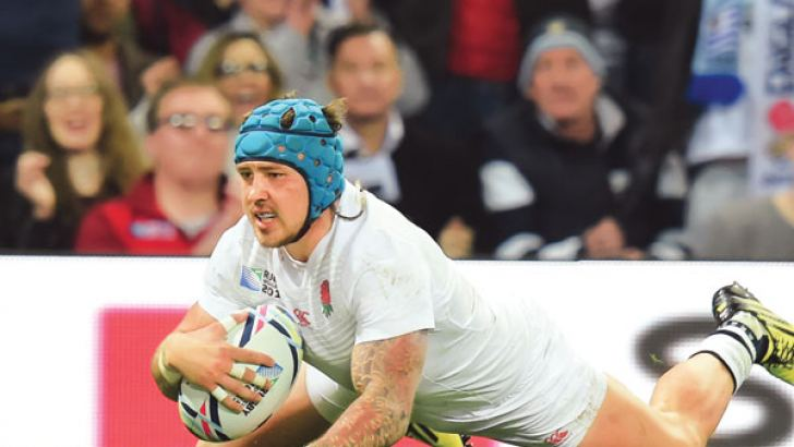 England's wing Jack Nowell scores his third and England's ninth try during the Pool A match of the 2015 Rugby World Cup between England and Uruguay at Manchester City Stadium in Manchester, northwest England, on October 10, 2015. AFP