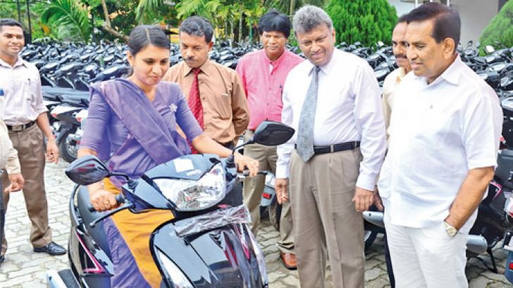 Health, Nutrition and Indigenous Medicine Minister Dr. Rajitha Senaratne participates at the motorcycle distribution ceremony