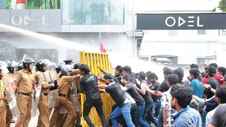 Police use water  cannon against the  protesting students.  Picture by Lalith C. Gamage