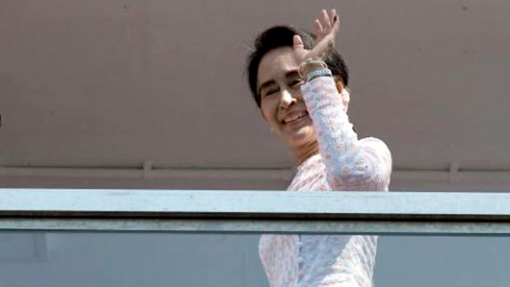 Myanmar Opposition Leader Aung San Suu Kyi waves after delivering a speech from the balcony of the National League of Democracy (NLD) headquarters in Yangon yesterday.