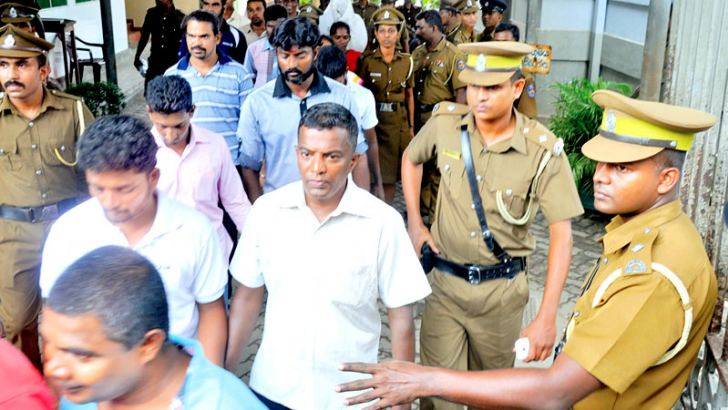 Some of the 31 suspected ex-LTTE members who were held in remand custody being taken to courts. Picture by Gayan Pushpika