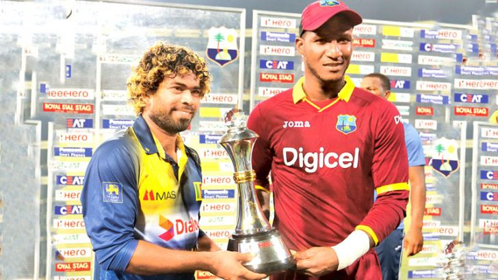 Sri Lanka captain Lasith Malinga and West Indies captain Darren Sammy share the Hero Cup after the two-match T20 international series was shared 1-all at the R Premadasa Stadium on Wednesday. Picture by Rukmal Gamage