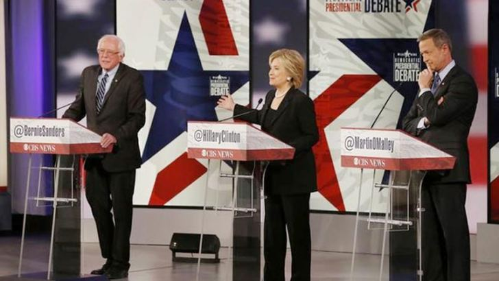Democratic US presidential candidates Senator Bernie Sanders, former Secretary of State Hillary Clinton and former Maryland Governor Martin O'Malley (R) participate in the second official 2016 US Democratic Presidential debate.