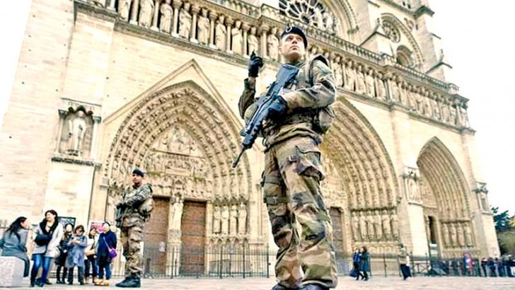 Soldiers patrol opposite the Notre Dame Cathedral on Tuesday as security is beefed up in Paris.
