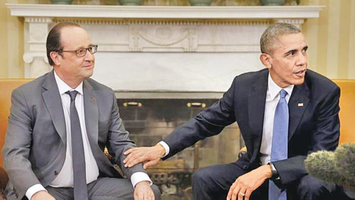 US President Barack Obama meets with French President Francois Hollande at the Oval Office of the White House on Tuesday.- AFP