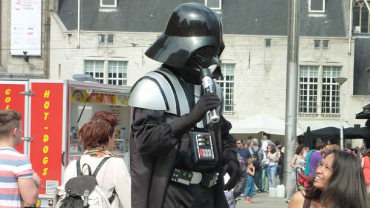 A street performer in costume as Darth Vader in Amsterdam. Vader is one of the most iconic characters of the Star Wars franchise.
