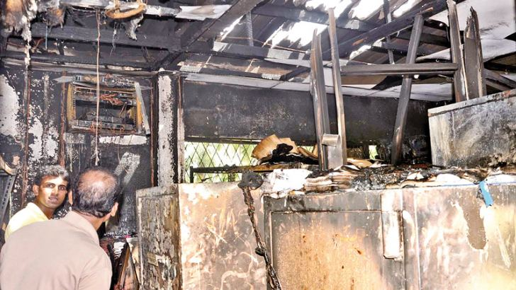 A fire  erupted inside a building owned by a state bank in Katunayake yesterday  morning. A part of the building was completely gutted. However no  injuries were reported. The Police with the help of fire fighters were  able to extinguish the flames after a few hours. The picture shows a  part of the building which was destroyed in the fire.