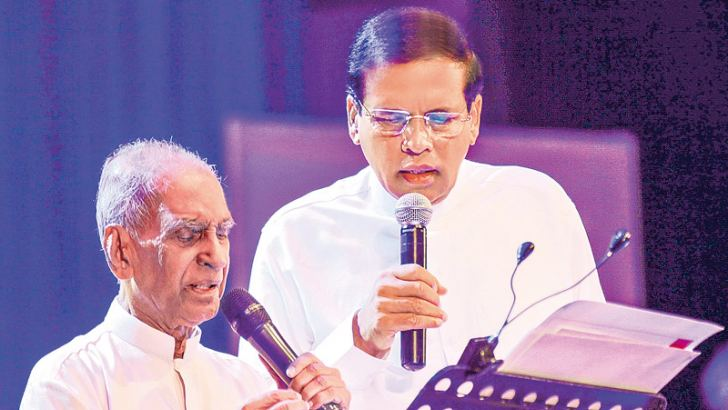 """President Maithripala Sirisena participated in the musical show 'Sasara Vasana Thuru' held on Saturday at the BMICH to felicitate veteran musician Pandit Amaradewa, in line with his 88th birth anniversary. """"The greatest musician of the nation of Sri Lanka, Pandit Amaradewa is a world renowned musician with heart-felt cordiality. He will be honoured not only by the people today, but also by future generations,"""" the President said. President Sirisena also joined Pandit Amaradewa to sing a few songs. Special P"""