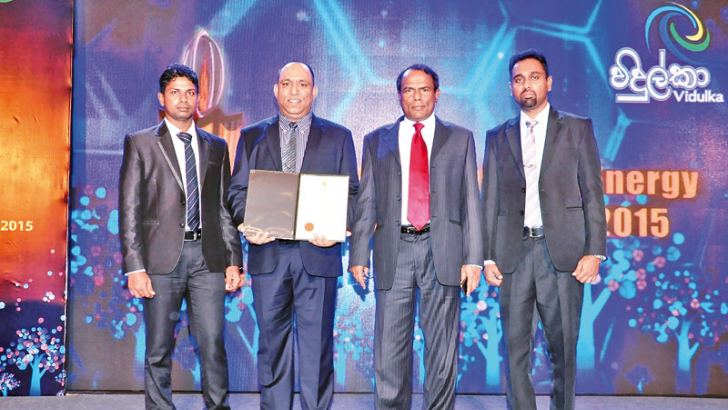 OHSE Executive Neel Prasanna , Engineering Deputy General Manager Pradeep de Silva,  Managing Director Tissa Eleperuma and Factory Engineer Neel Susantha receiving the award.