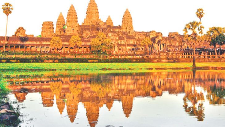 The sun sets over Angkor Wat temple in Siem Riep, Cambodia. - AFP