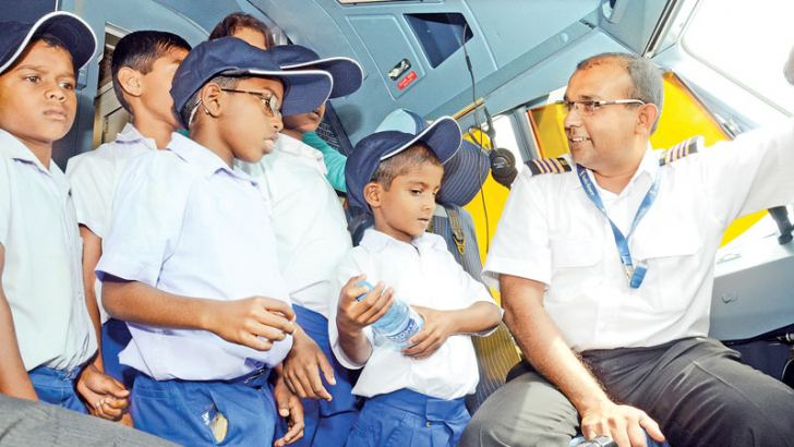 Schoolchildren from the remote village of Meemure, located in the Knuckles Mountain Range made a three day educational trip to Colombo courtesy the Silumina newspaper published by Lake House. Among the key location they visited was the Bandaranaike International Airport, Katunayake. The picture shows some students inside the cockpit of SriLankan Airlines' biggest airbus getting first hand information from one of the officers. Pictures by Wimal Karunatilake