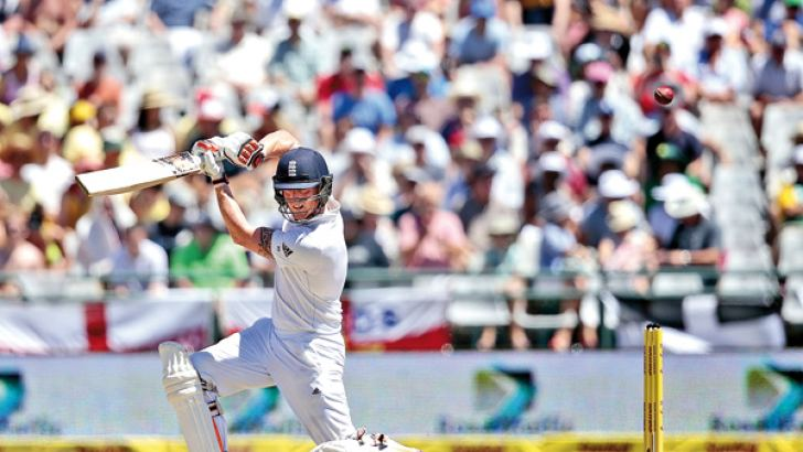 Englands batsman Benjamin Stokes plays a shot during the day two of the second Test match between England and South Africa at Newlands stadium on January 3, 2015 in Cape Town, South Africa. AFP