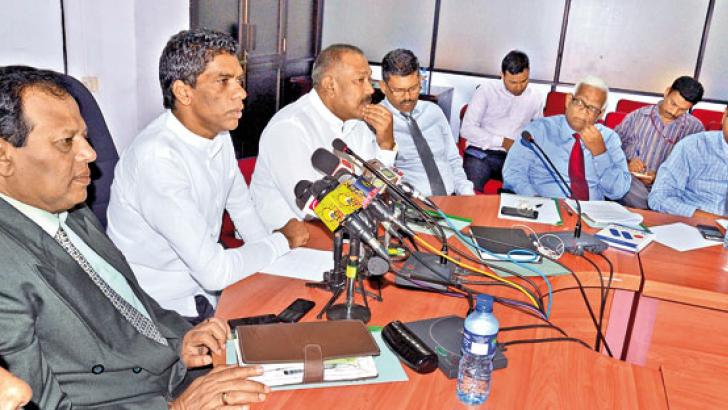 Hill Country New Villages Infrastructure and Community Development Minister P. Thigambaram and other officials at the press conference. Picture by Vipula Amarasinghe