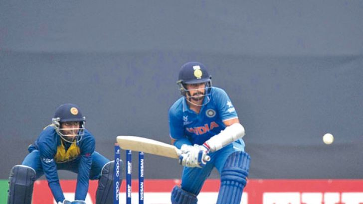 India's Anmolpreet Singh who top scored with 72 looks to sweep the ball during the Under-19 World Cup semi-finals against Sri Lanka in Mirpur watched by Sri Lanka wicket-keeper Randika de Silva who held onto five catches.