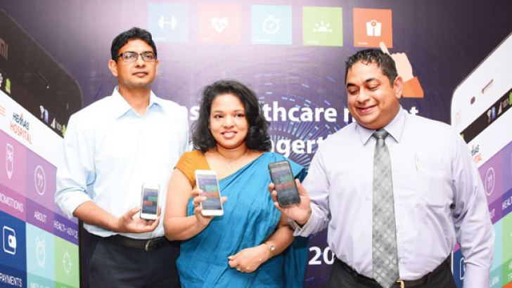 Hemas Hospital Managing Director Dr Lakith Peiris, Director and General Manager Dr. Chamila Ariyananda and Chief Process Officer of Hemas Hospital Chandima Cooray at the Mobile App launch. Picture by Rukmal Gamage