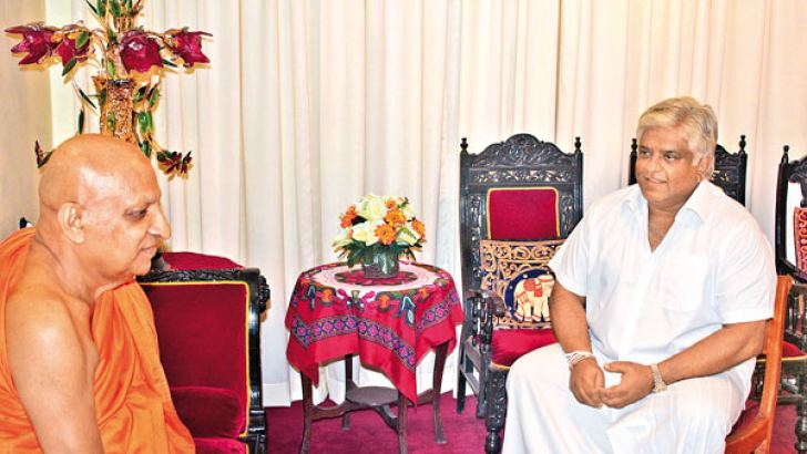 Ports and Shipping Minister Arjuna Ranatunga called on the Mahanayake Theras of the Asgiriya and Malwatte Chapters yesterday