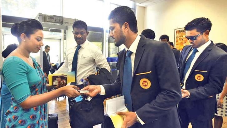 The Sri Lanka cricket team captained by Angelo Mathews left for England on SriLankan Airlines UL503 yesterday. They were met at the airport by SriLankan crew members before their departure. Vice-captain Dinesh Chandimal has his passport checked at the airport by one of the SriLankan Airlines stewardesses.
