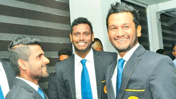 Sri Lanka cricket captain Angelo Mathews (centre) shares a joke with his Test openers Kaushal Silva and Dimuth Karunaratne at SLC headquarters before the team's departure to England yesterday. (Pictures by Thushara Fernando)