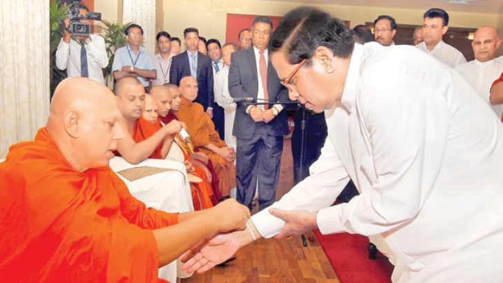 President Maithripala Sirisena who returned to the country yesterday after attending the G7 Outreach Summit in Japan, is seen participating in religious observances at the Bandaranaike International Airport, Katunayake.