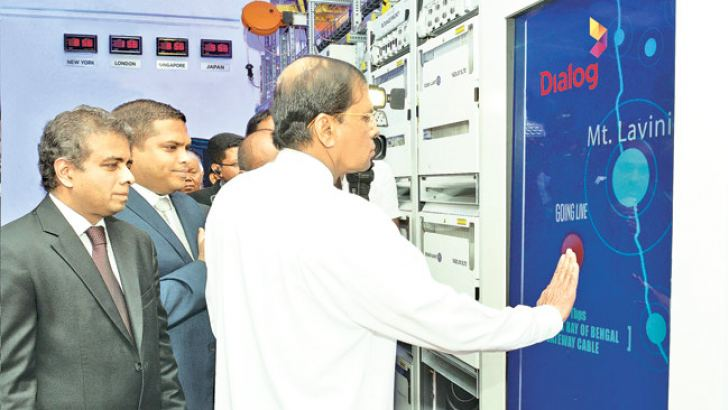 President Maithripala Sirisena, Commissions  Gateway Submarine Cable at Dialog's Cable Landing Station in Mount Lavinia. Looking on are Harin Fernando, Minister of Telecommunications and Digital Infrastructure and Dialog Axiata Group Chief Executive, Dr. Hans Wijayasuriya.