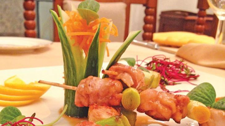Negima Yakitori-  A delectable skewer of Grilled Chicken Leg in Yakitori Sauce accompanied by a serving of Leeks