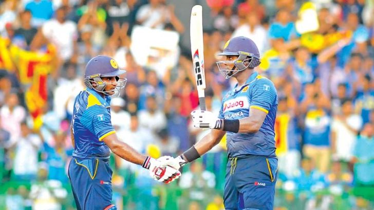 Angelo Mathews reaches fifty and is congratulated by his partner Kusal Perera in the second ODI against Australia played at the R Premadasa Stadium yesterday.