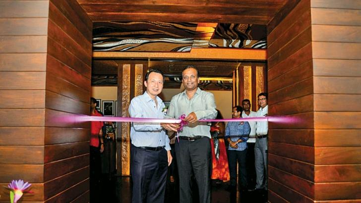 Softlogic Group Chairman and  Managing Director Ashok  Pathirage cutting the ribbon to declare the restaurant open with Thai Ambassador to Sri Lanka Nopporn Adchariyavanich