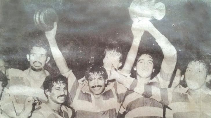 CH&FC skipper K.H. Karunasena holds aloft the Clifford Cup which they won in 1982.