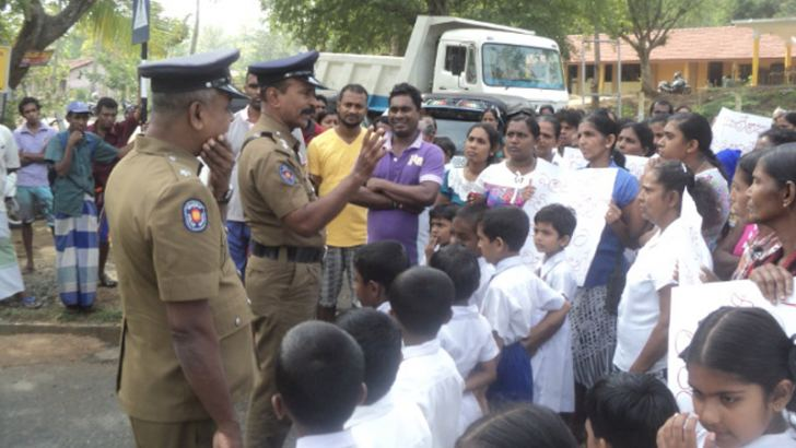 Inspector S. Ranaweera discussing with parents.