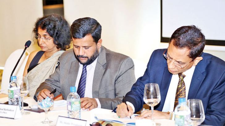 """Minister of Industry and Commerce Rishad Bathiudeen (centre) at opening of WTO's Colombo session """"Trade Led Development in the Multilateral Trading System"""" joined by Head of WTO Development Division Shishir Priyadarshi (right) and Director General of Commerce Sonali Wijeratne (left) at Colombo Hilton."""