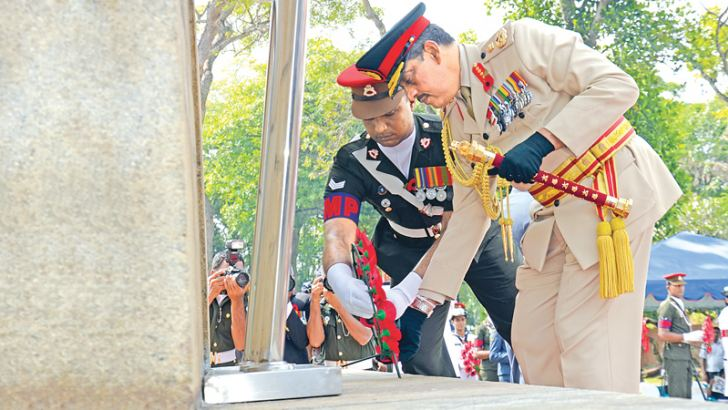Regional Development Minister Field Marshal Sarath Fonseka placing a wreath at the War Memorial in Colombo during Poppy Day ceremonies held yesterday in memory of military personnel who sacrificed their lives in the two world wars and those who sacrificed their lives to safeguard the unity and territorial integrity of the country. Defence Secretary Karunasena Hettiarachchi, Service Chiefs, members of the Diplomatic Corps and families of departed war heroes were also present. Picture by Wimal Karunatilleke