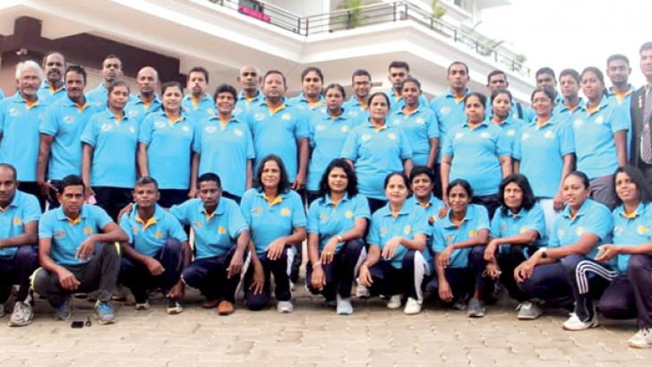 The Sri Lanka Veteran Mercantile athletic team that won 98 medals in Mangalore.