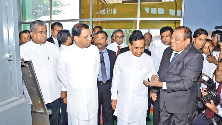President Maithripala Sirisena commissioning the new plant.The new machine processing maize for Thriposha.Pictures by Sudath Malaweera