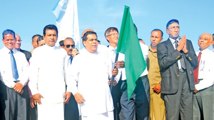 Transport and Civil Aviation Minister Nimal Siripala de Silva inaugurating work on the runway overlay at the BIA yesterday.