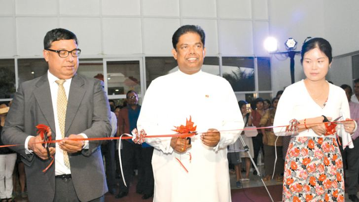 NFC Chairman Deepal Chandrarathne, Parliamentary Reforms and Mass Media Minister Gayantha Karunathilaka and Political Counselor at the Embassy of China in Sri Lanka, Pang Chunxue cutting the ribbon.
