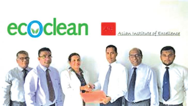 M.R. Saban, COO from Ecoclean handing over the contract to Arosha Jayasundera, CEO, AIE looked on by Anfas Rifkhan, Business Development Manager, Sujith Hettiarachchi ,  General Manager, Sunil Perera and Dr Preethi Wanasinghe