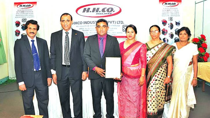 ISO Chairman, Pradeep Gunawardane, SLSI Chairman Gamini Dharmawardane, HHCO INDUSTRIES Managing Director Chinthana Sujeeva Ganegoda, Director Nalika Jayamini and officials with the SLS certification.