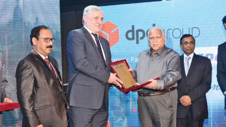 Aitken Spence Chairman Harry Jayawardena exchanging a momento with  GeoPost SA Executive Vice President Arnold Schroven while DTDC Express  Director Suresh Bansal,  DTDC Express Chairman and Managing Director Dr.  Subhasish Chakraborty, Aitken Spence Deputy Chairman and Managing  Director J M S Brito and Aitken Spence Maritime and Cargo Logistics    Chairman and CEO Dr. Parakrama Dissanayake look on.
